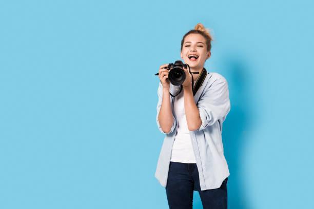 Young blonde photographer is enjoying her work model isolated on a picture id815730610?b=1&k=6&m=815730610&s=612x612&w=0&h=o0kx1h2xnitxdwyhqh0tk7g rpblrhurkkxnq2zxqkc=