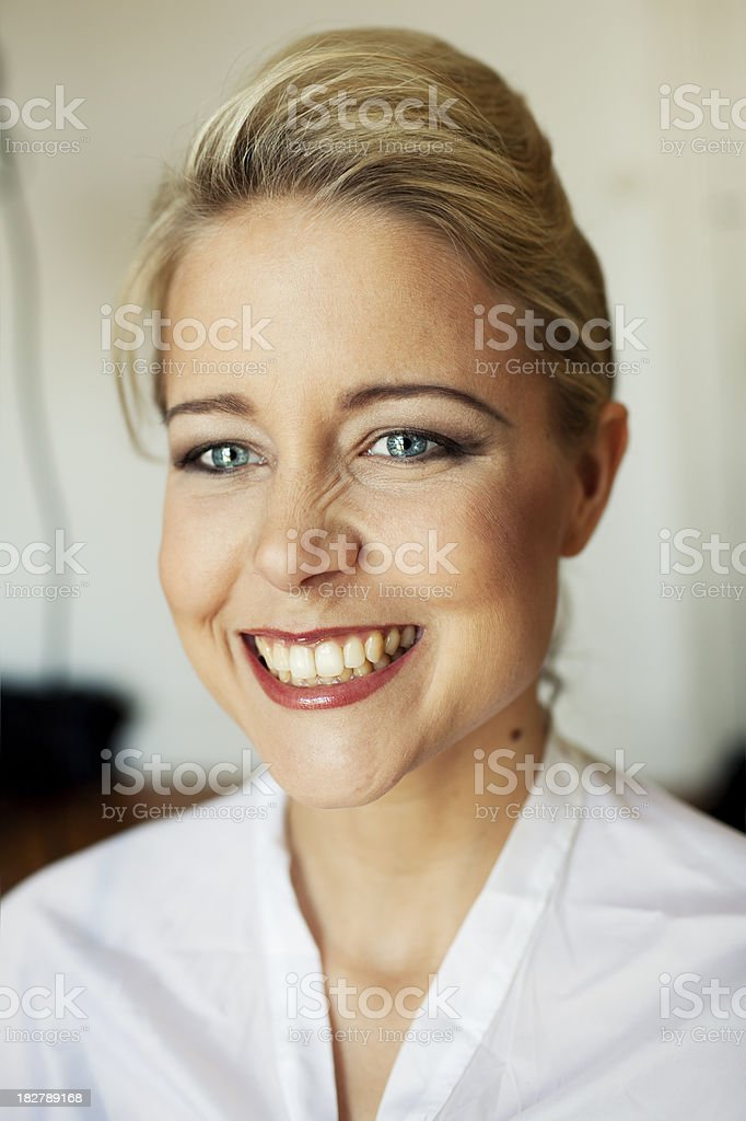 young blonde smiling candid woman indoor royalty-free stock photo