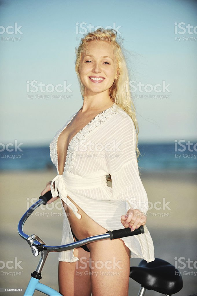 Young Blonde Woman Bikini Model On Bicycle At Beach Stock