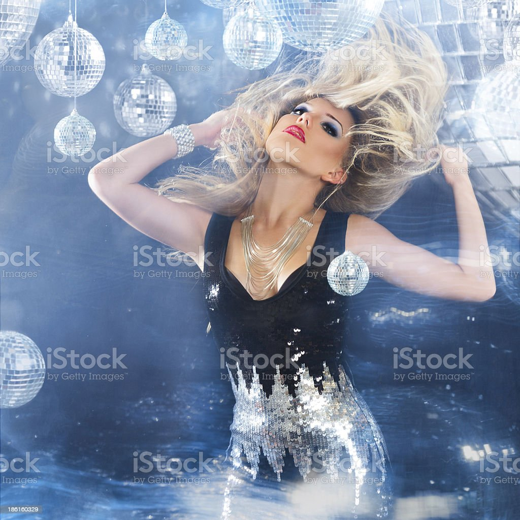 Young blonde woman dancing at night disco club royalty-free stock photo