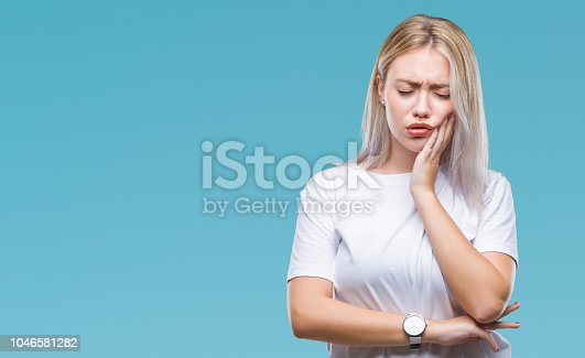 Young blonde woman over isolated background touching mouth with hand with painful expression because of toothache or dental illness on teeth. Dentist concept.
