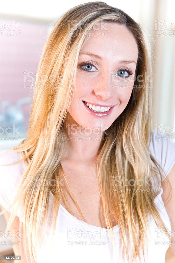 Young blonde woman smiling at camera stock photo
