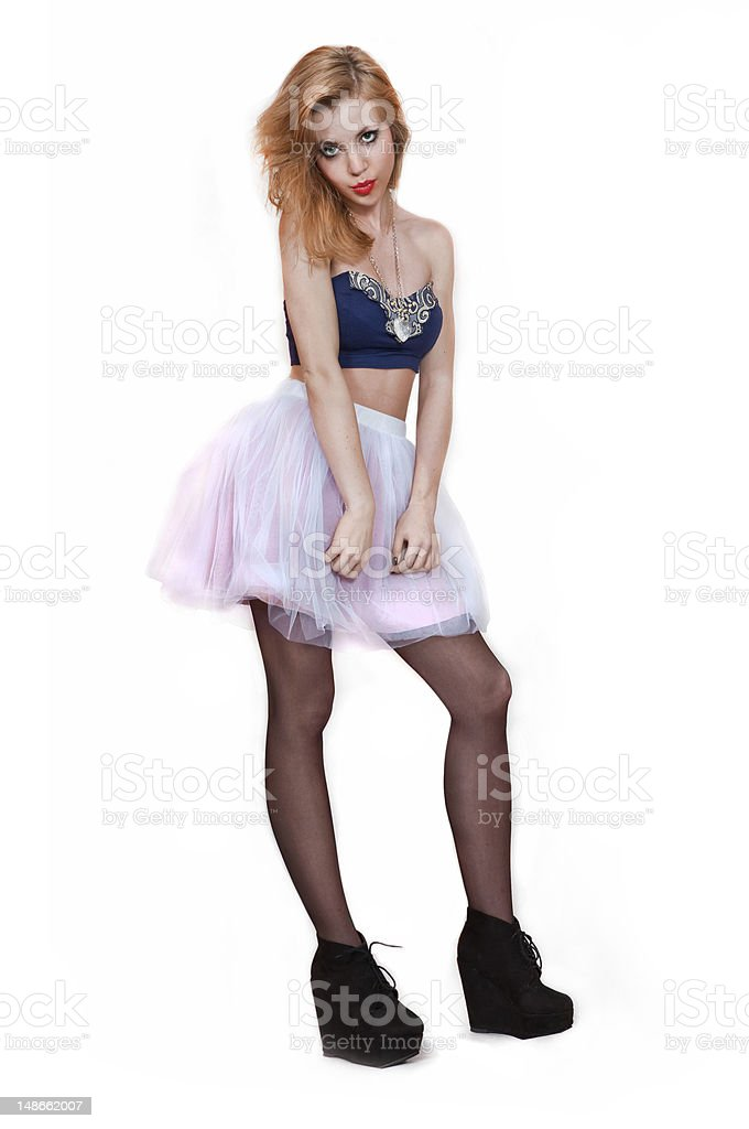 Young Blonde Women in pink skirt and blue top royalty-free stock photo