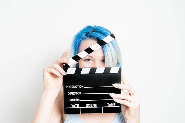 young blue eyes blonde woman with movie clapper - audition stock photos and pictures