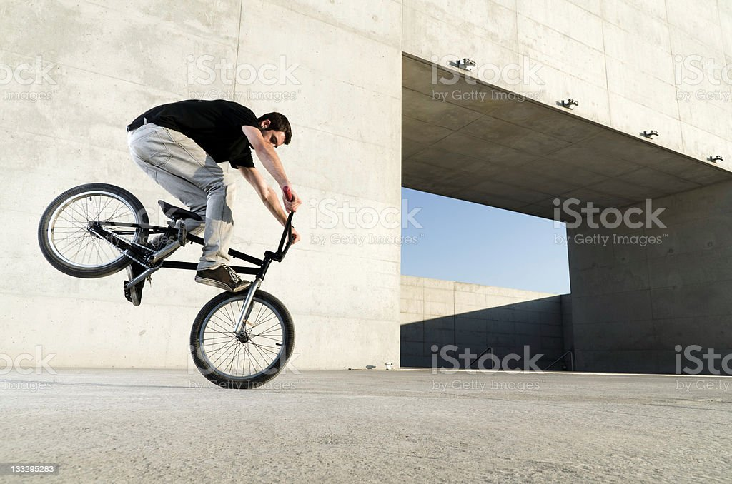 Young BMX bicycle rider stock photo