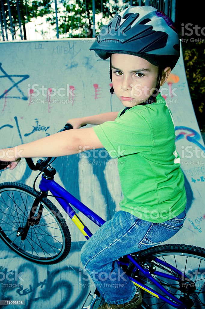 young boy, 6 years, riding his bmx bike in small half-pipe, action...