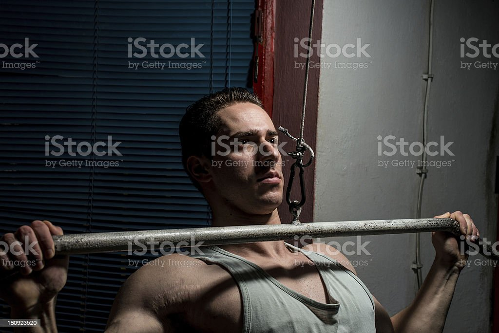 young body builder doing heavy weight exercise for back royalty-free stock photo