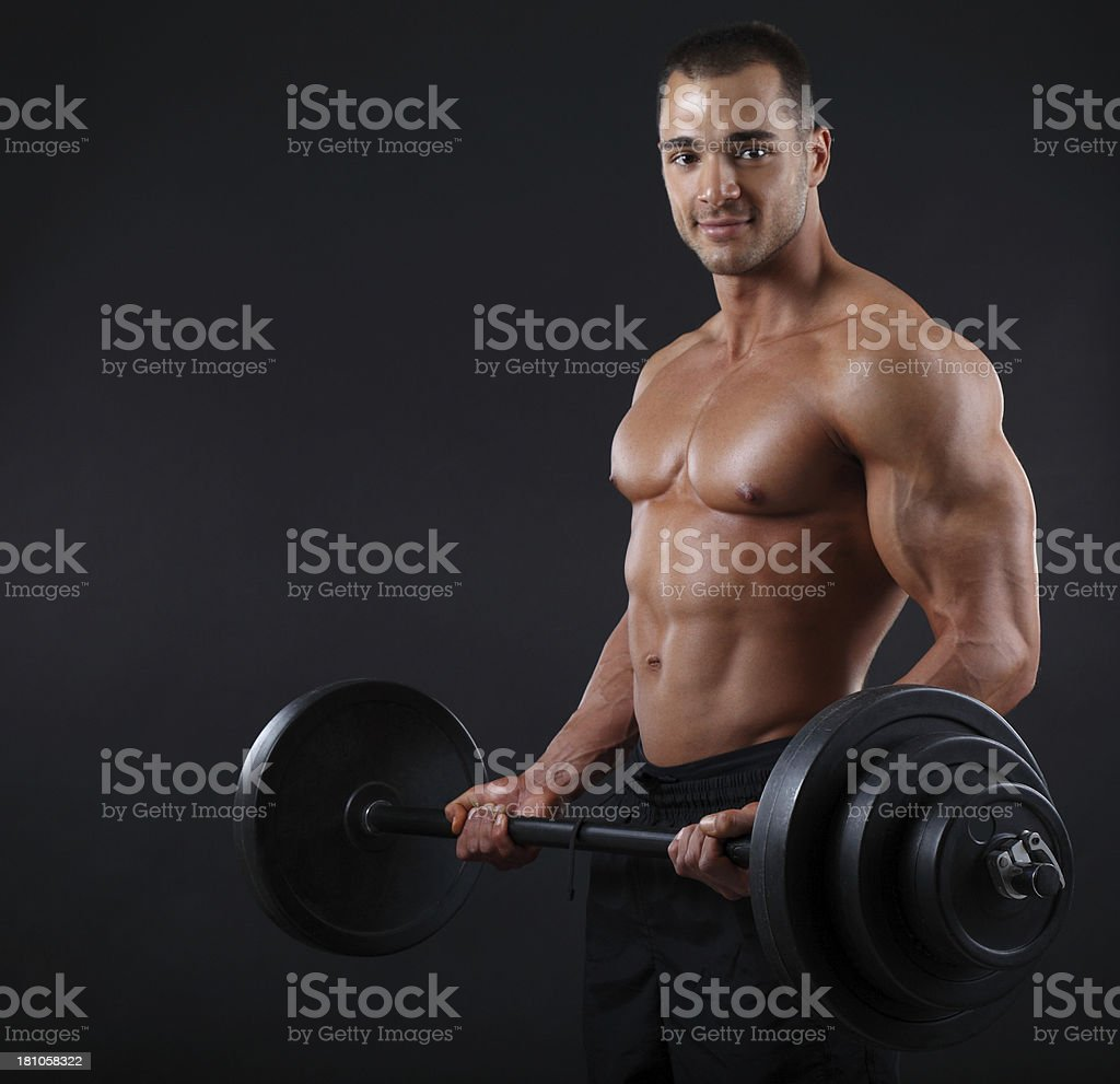 Young bodybuilder exercising royalty-free stock photo