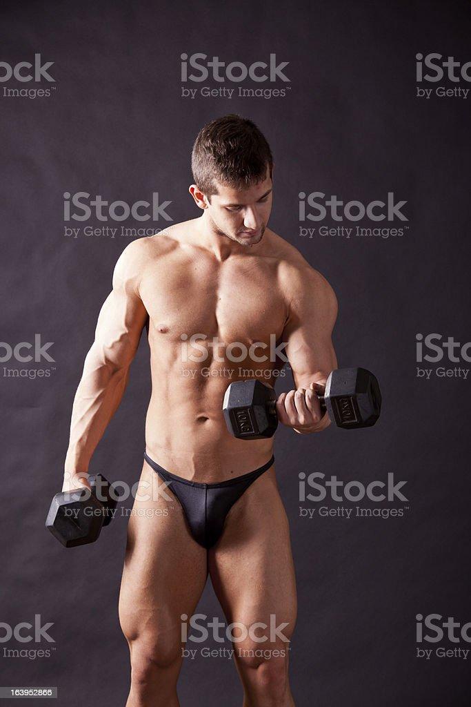 young bodybuilder traininig royalty-free stock photo