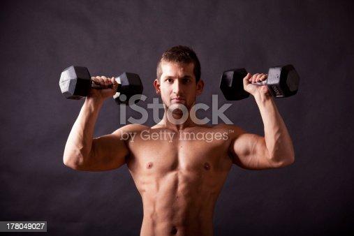 618638418istockphoto young bodybuilder traininig 178049027