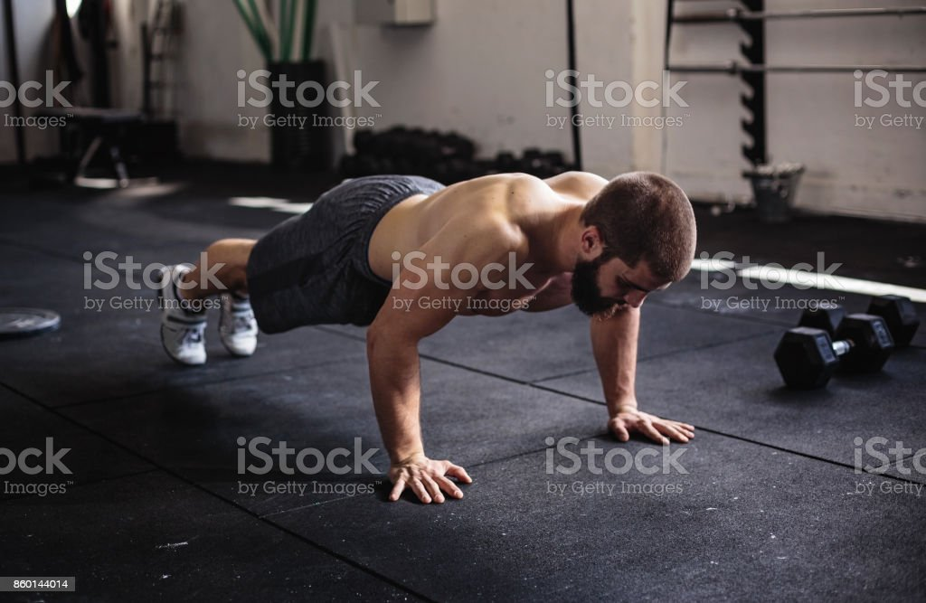 Young bodybuilder working on his strength stock photo