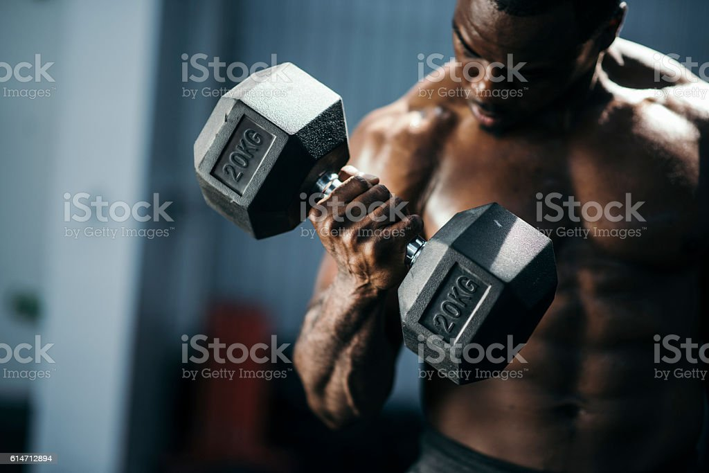 Young bodybuilder working out stock photo