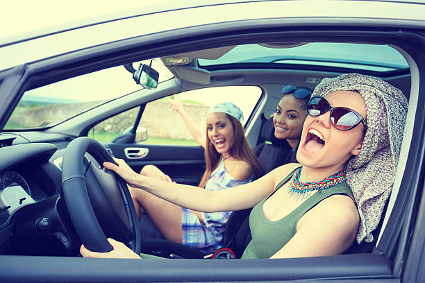 young boho women traveling and listening music in the car - radio kultur stock-fotos und bilder