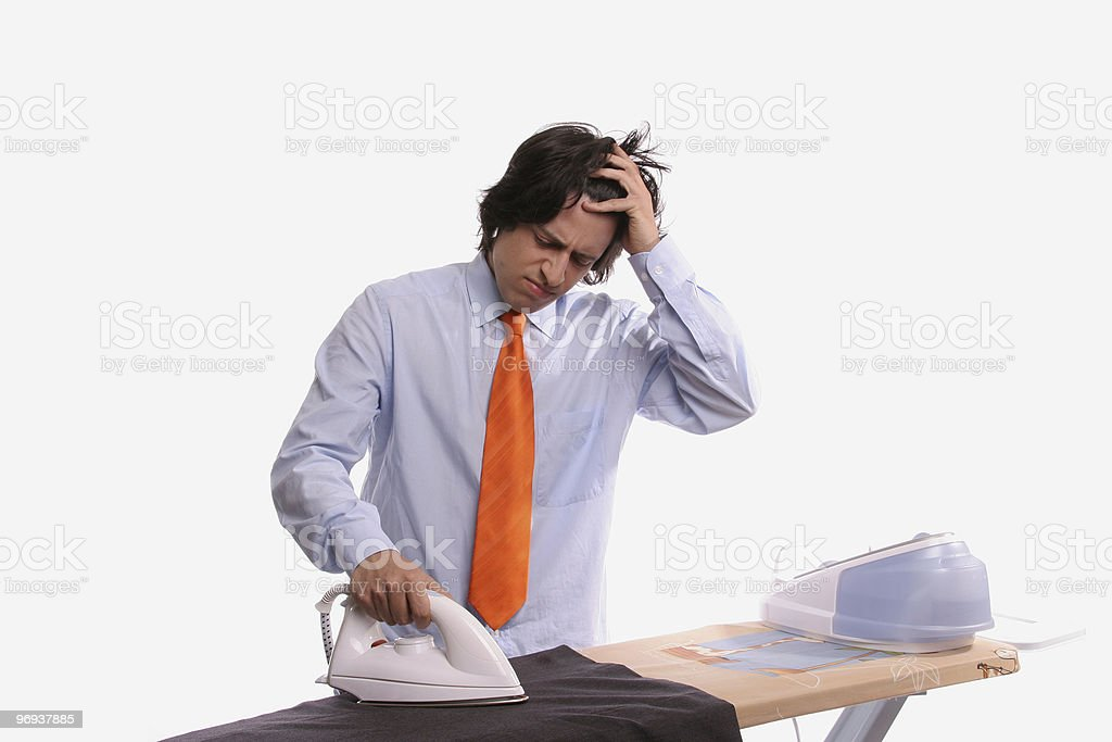 Young bored bussinessman doing the ironing royalty-free stock photo
