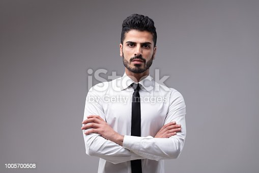 istock Young bossy man with white shirt and necktie 1005700508