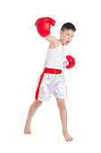 Young asian boxer boy over white background