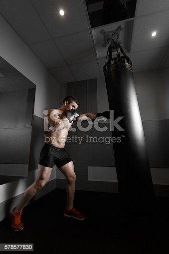 istock Young boxer trains on punching bag 578577830