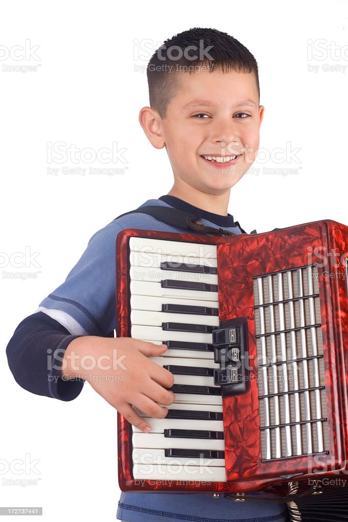 Young boy and accordion royalty-free stock photo