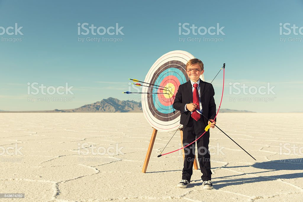 Young Boy and Business Archer With Target stock photo
