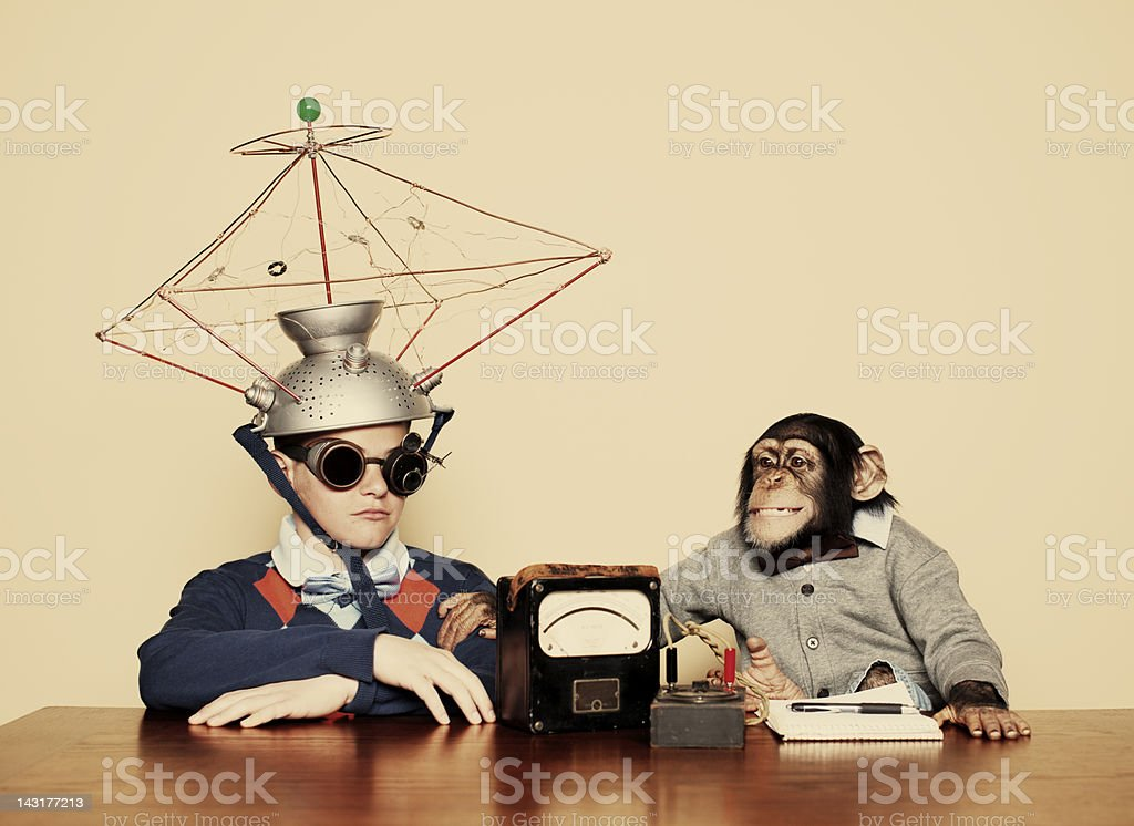 Young Boy and Chimpanzee Conduct Mind Reading Experiment stock photo