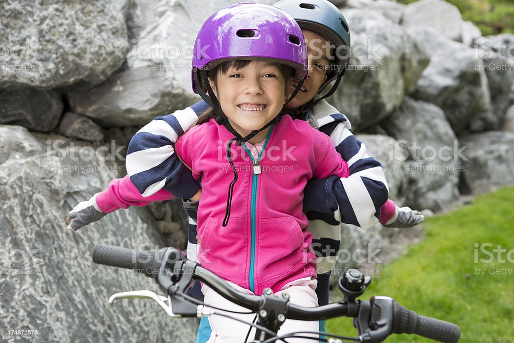 Young boy and girl bicycling royalty-free stock photo