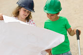 """Child, playing outdoors, construction worker"""