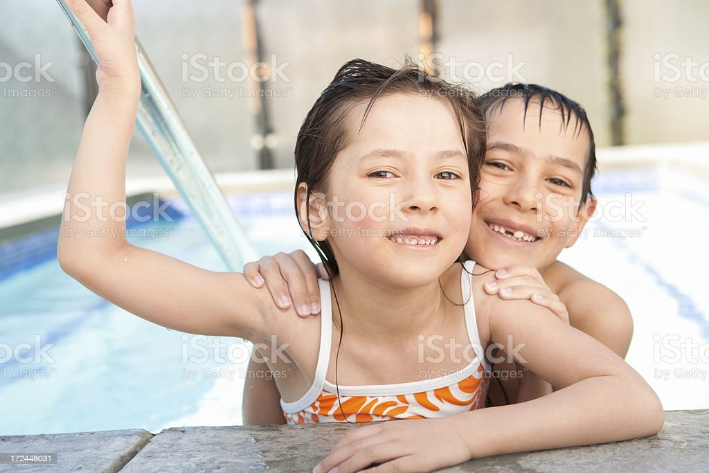 Young boy and girl relaxing in the hot tub royalty-free stock photo