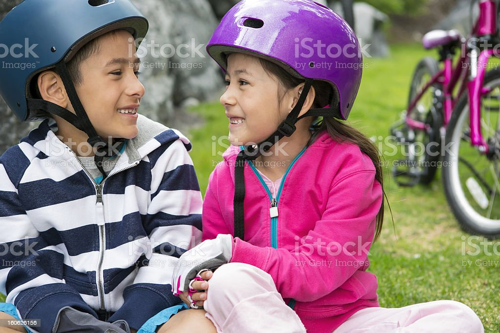 Young boy and girl taking a break from bicycling royalty-free stock photo