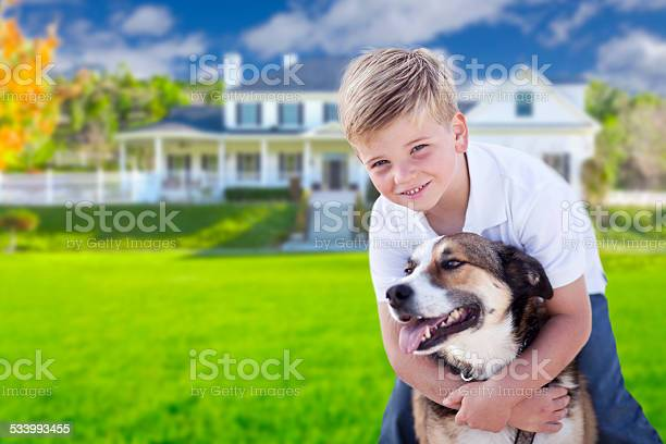 Young boy and his dog in front of house picture id533993455?b=1&k=6&m=533993455&s=612x612&h=5lrz bhurz l0xjxgvvfwig5fa ev90bksf iftmoci=