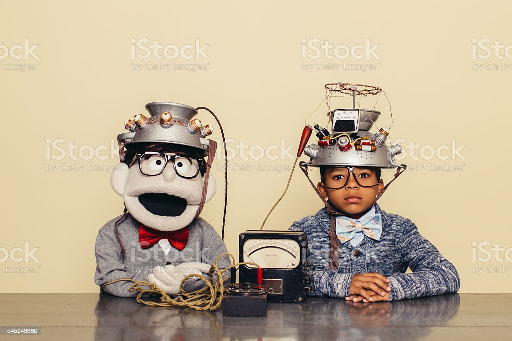 Young Boy and Puppet Dressed as Nerds Testing Telepathy stock photo