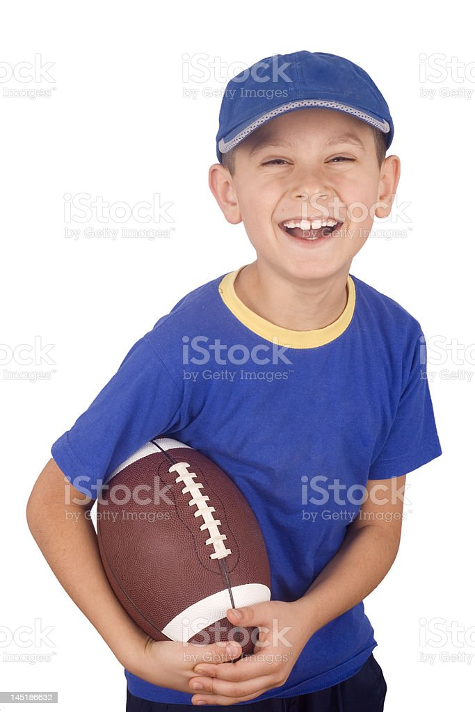 Young boy and rugby ball royalty-free stock photo