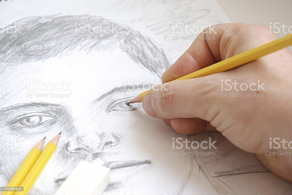 A young boy being sketched by a male hand stock photo