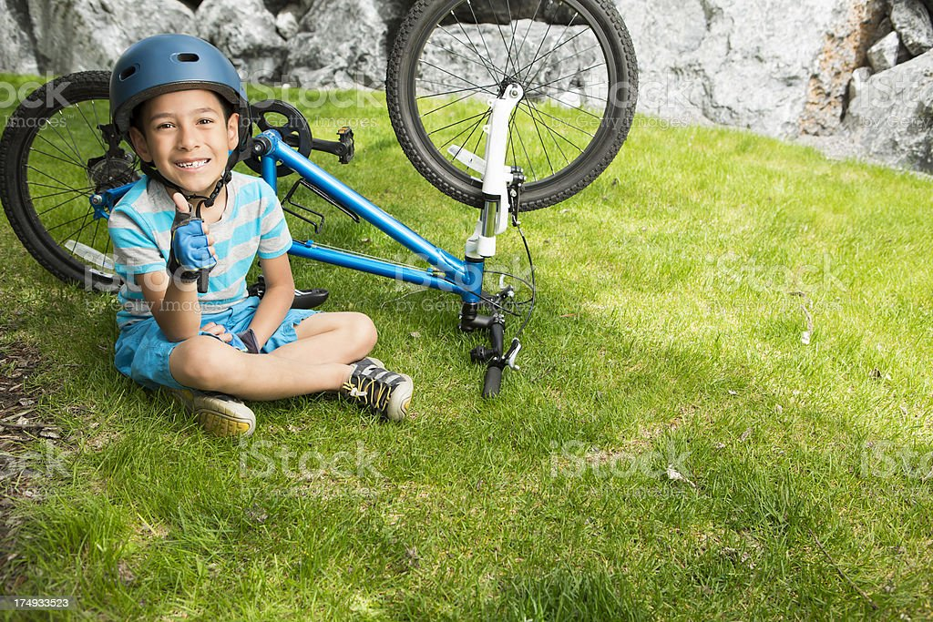 Young boy biking in the mountains royalty-free stock photo