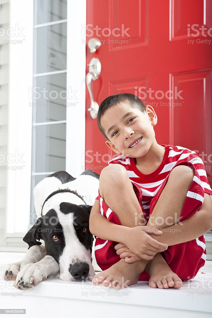 Young boy bonding with his dog royalty-free stock photo