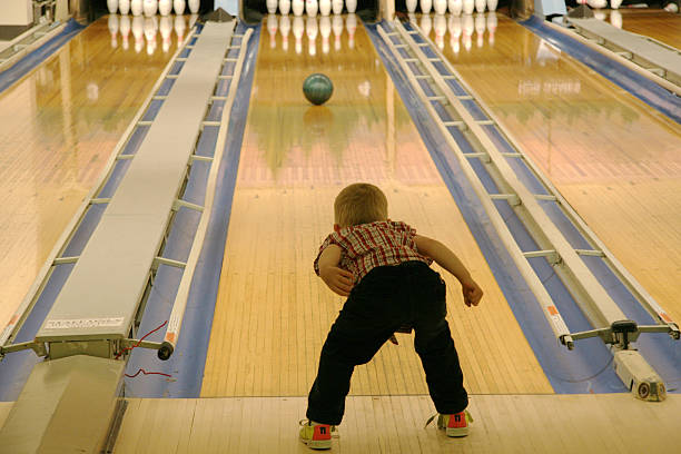 young boy bowling - young singles stock photos and pictures