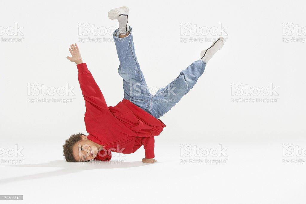 Young boy break dancing indoors stock photo