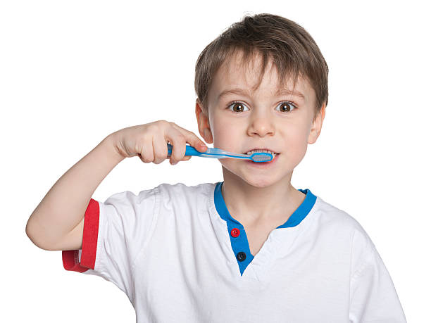 Junge Zähne putzen Ihre – Foto