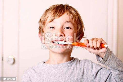 istock Young Boy Brushing 184107065