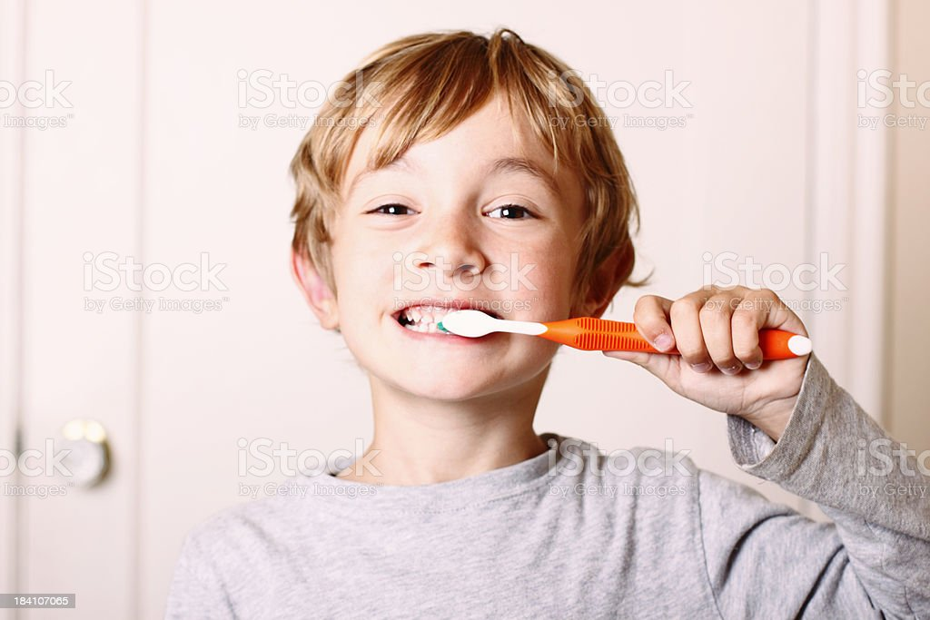 Young Boy Brushing stock photo