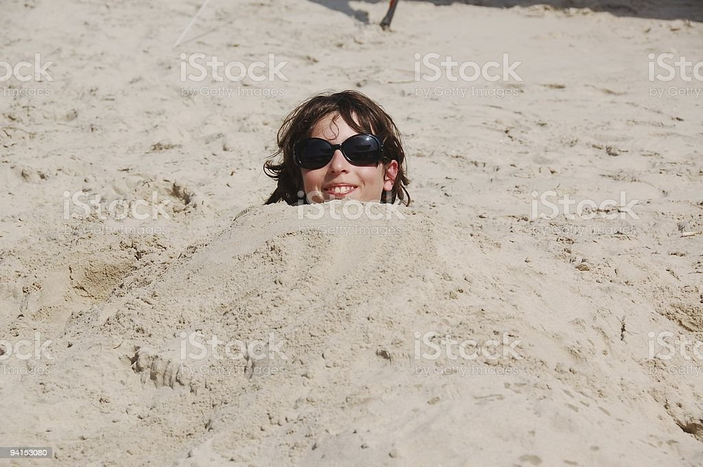 Young Boy Buried stock photo