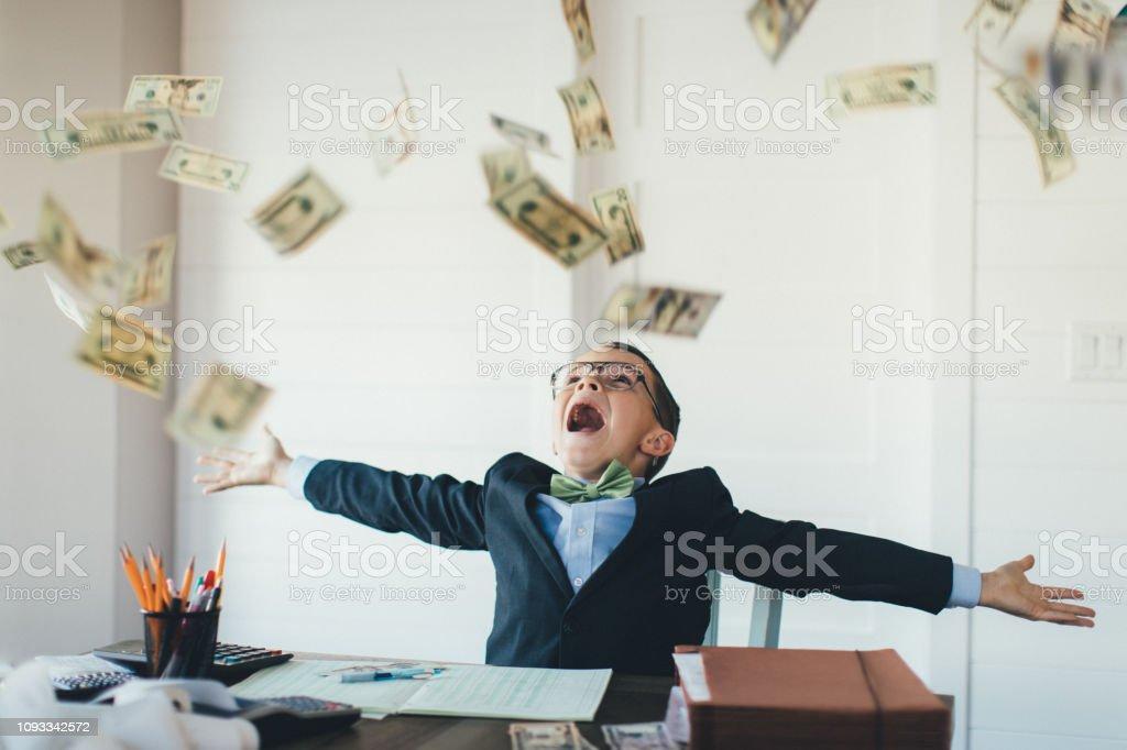 Young Boy Businessman Catching Falling Money - Стоковые фото 10-11 лет роялти-фри