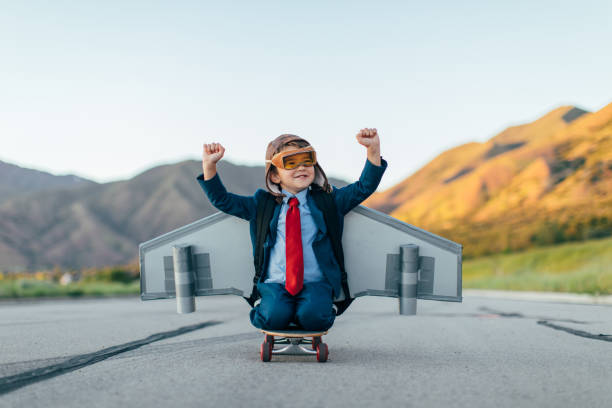 Young Boy Businessman Flying with Jet Pack on Skateboard