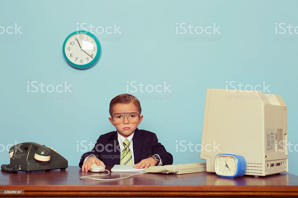 Young Boy Businessman Is Bored at the Office stock photo