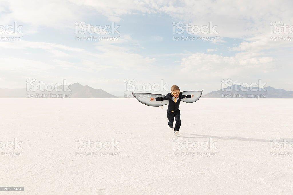 Jeune garçon Homme d'affaires, le Flying Away - Photo