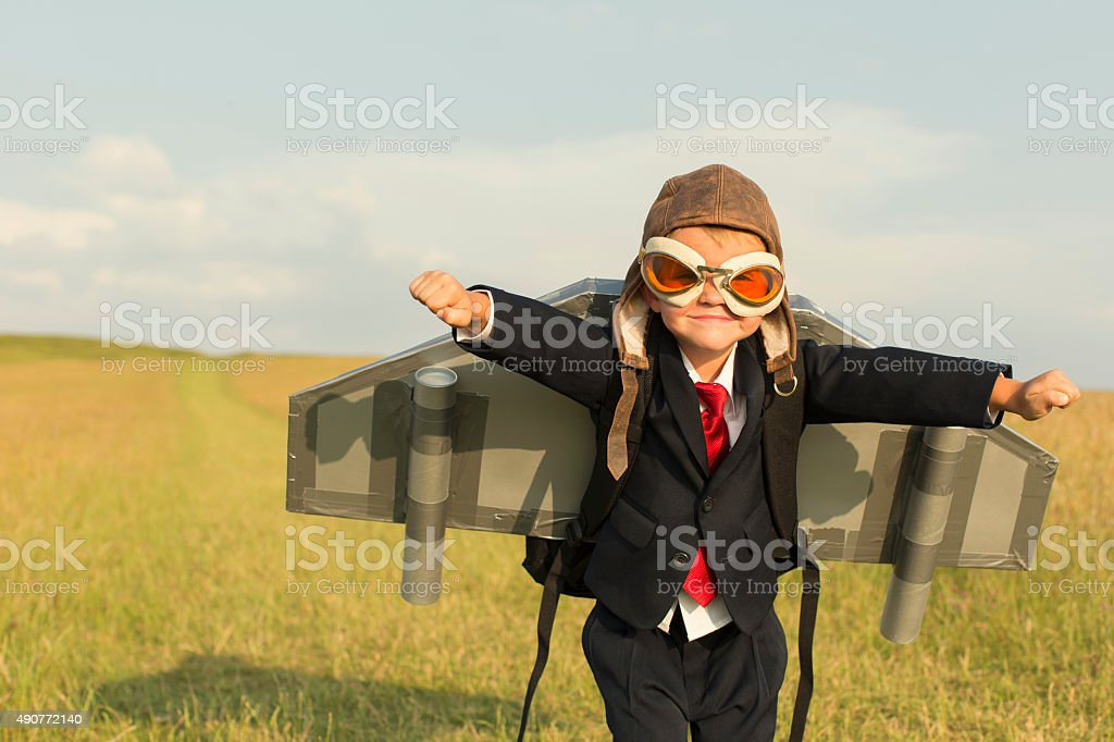 Young Boy Businessman Wearing Jetpack in England stock photo