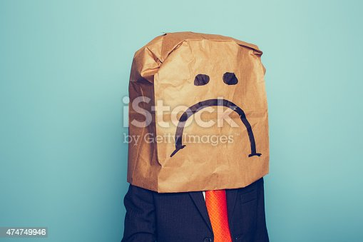 istock Young Boy Businessman Wears Sad Face 474749946