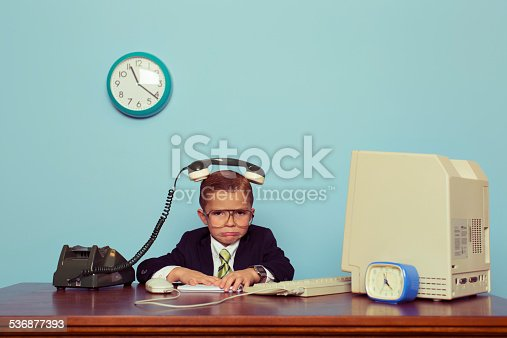 A young boy and businessman is frustrated with the telephone on his head. He is not sure how to solve complex business problems. Retro styled.