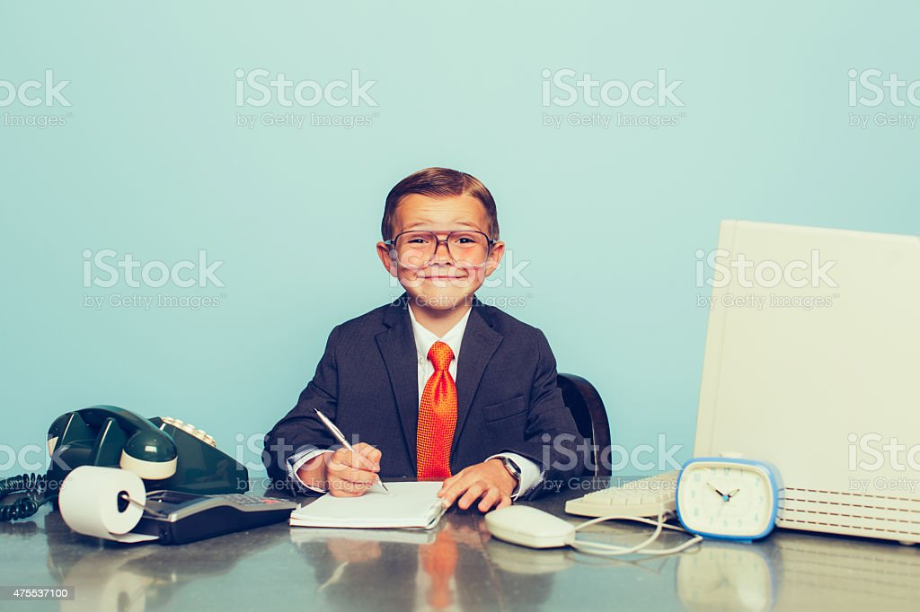 Young Boy Businessman Working at the Office stock photo