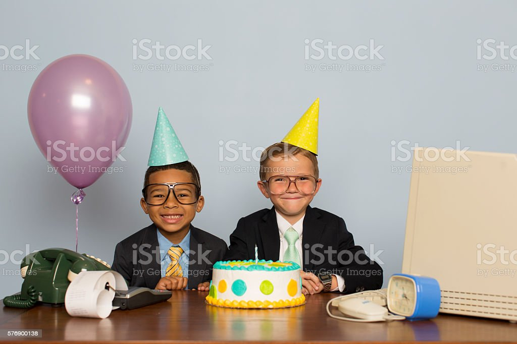 Young Boy Businessmen Celebrate with Business Birthday Cake stock photo