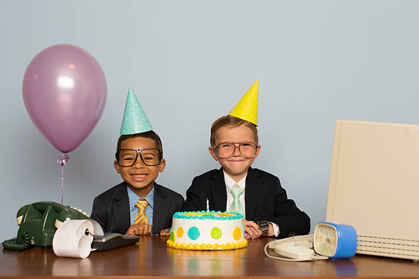 young boy businessmen celebrate with business birthday cake - aniversario fotografías e imágenes de stock